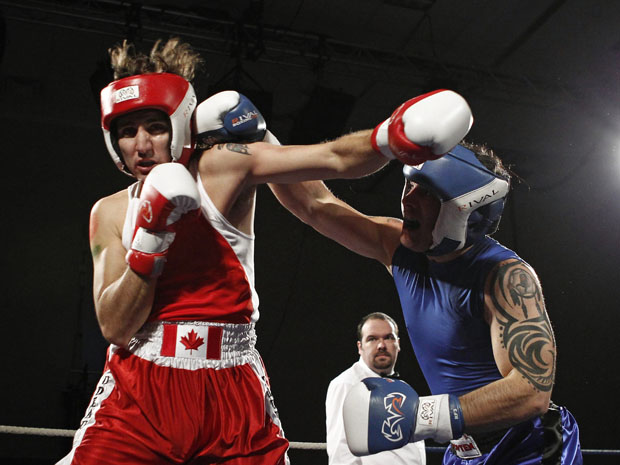 Liberal MP Trudeau and Conservative Senator Brazeau fight during their charity boxing match in Ottawa